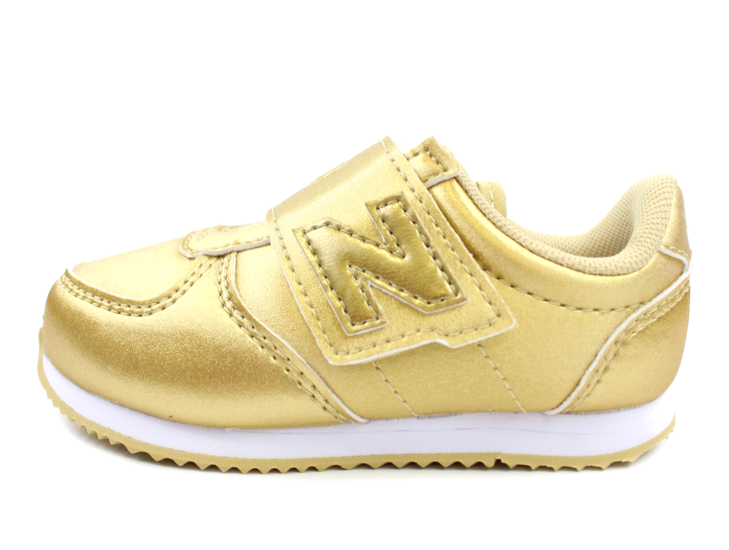 separation shoes c87d1 33f2b New Balance sneaker gold